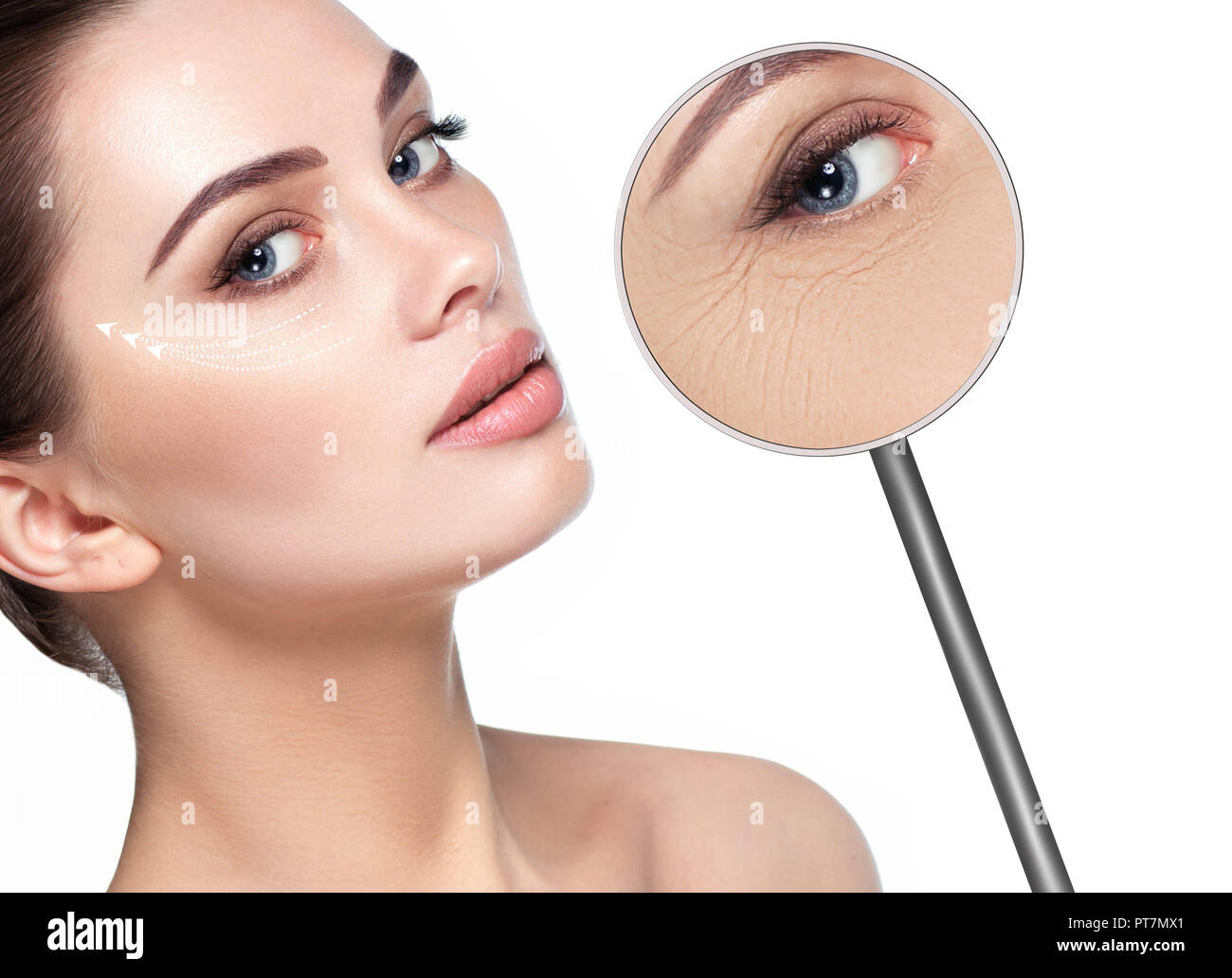 magnifying glass showing Wrinkles around the eyes - Stock Image