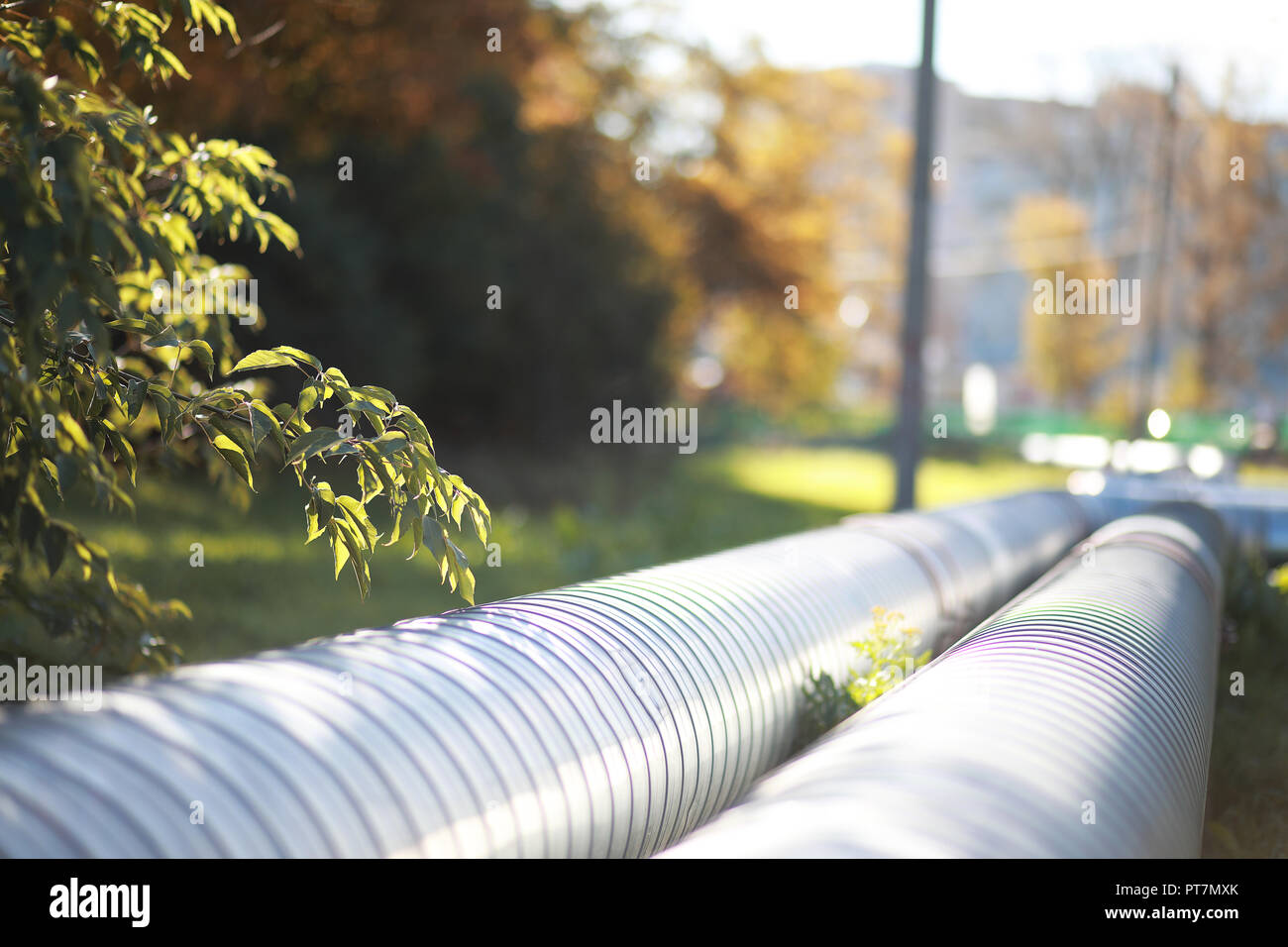 Industrial pipes on street construction - Stock Image