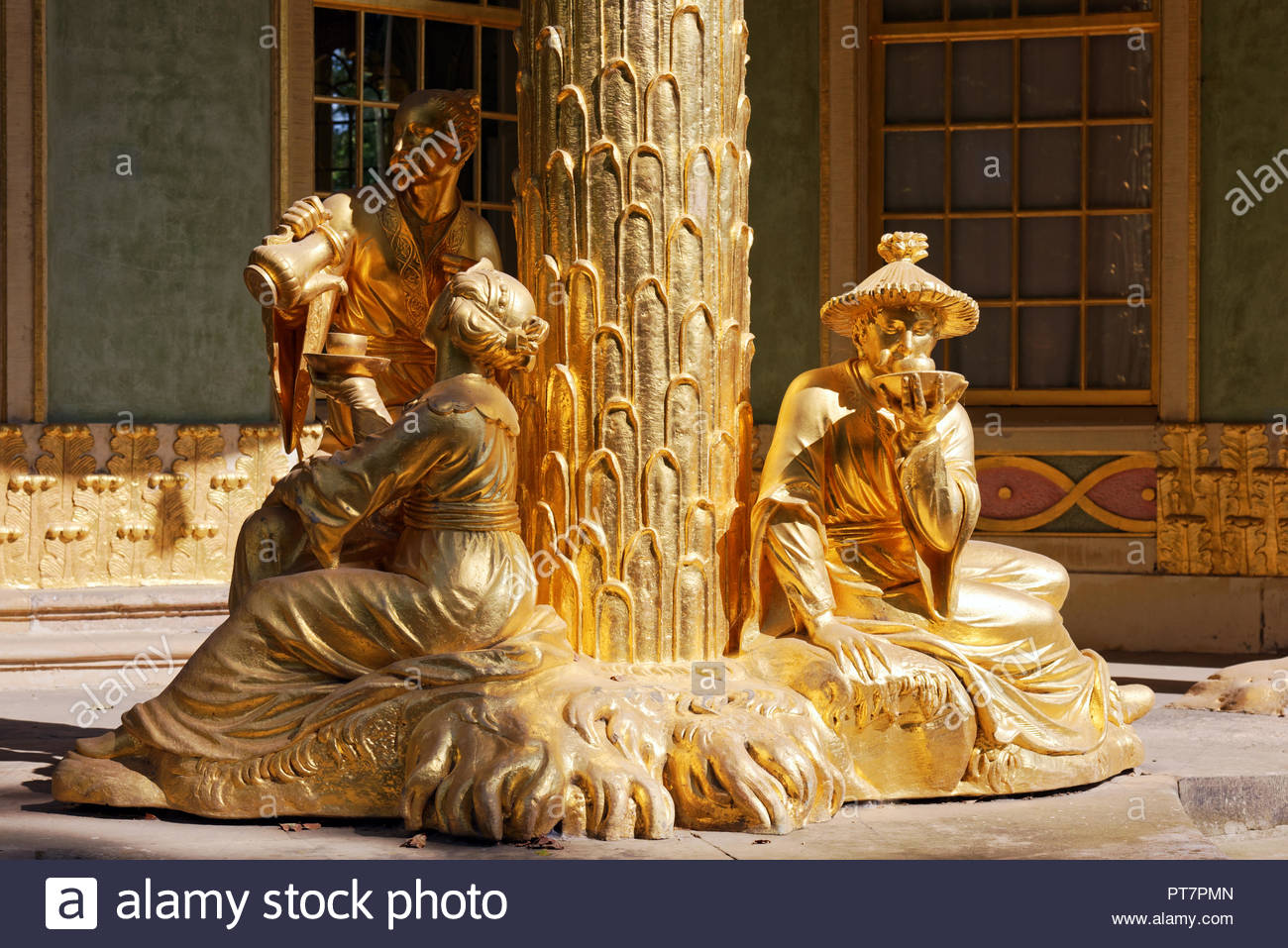 Potsdam, Germany - September 12, 2018: Gilt sculptures at Chinese House in Sanssouci Park. The park is the part of UNESCO World Heritage site since 19 - Stock Image