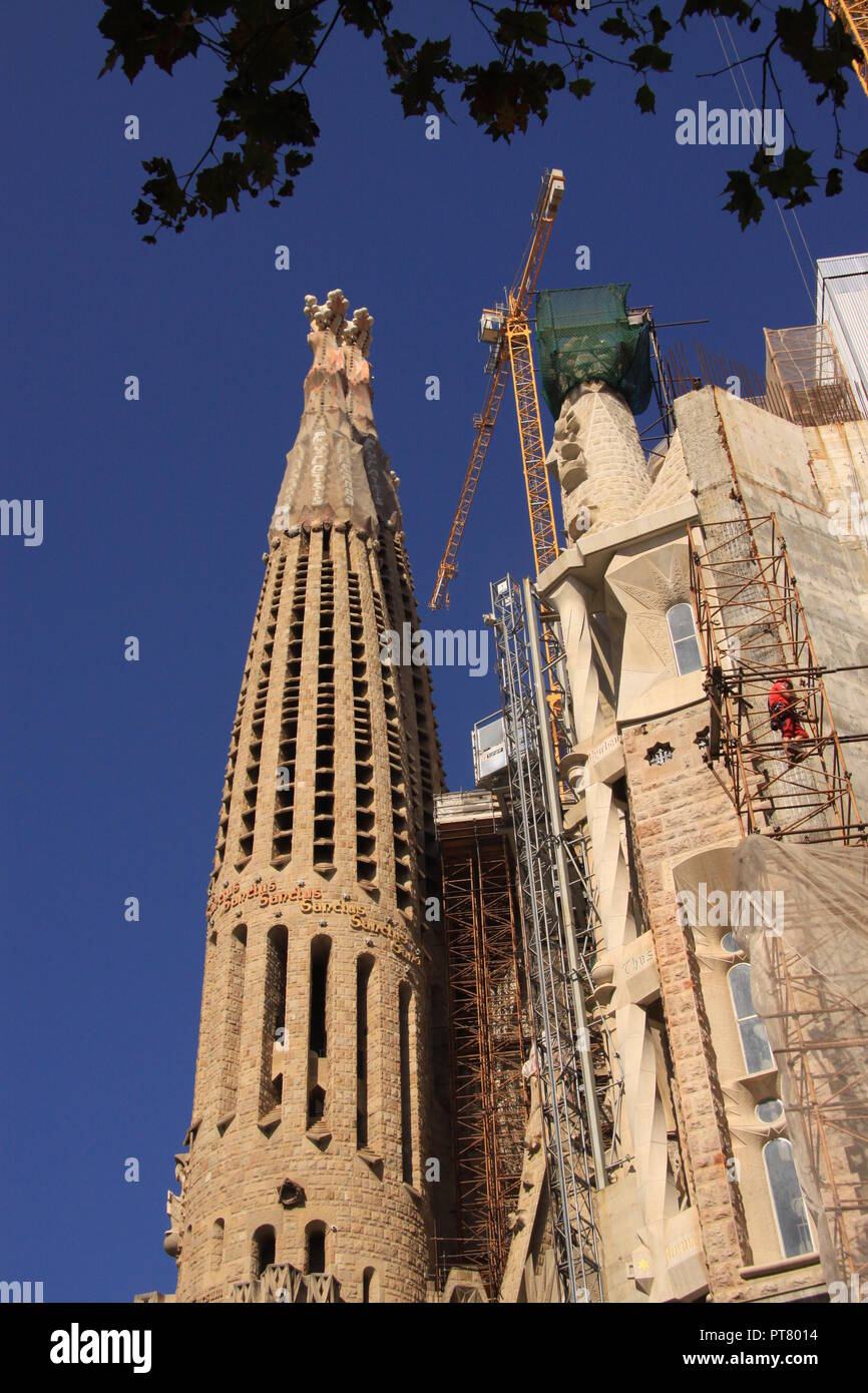 Workmen Working On The Unfinished Church Of Sagrada Familia In The