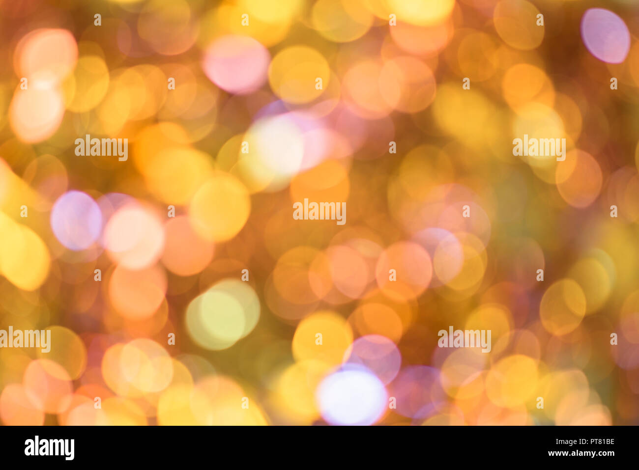 Background texture full of unsharp blurring golden yellow and cute pink shining bokeh lens aesthetic aberration effect. - Stock Image