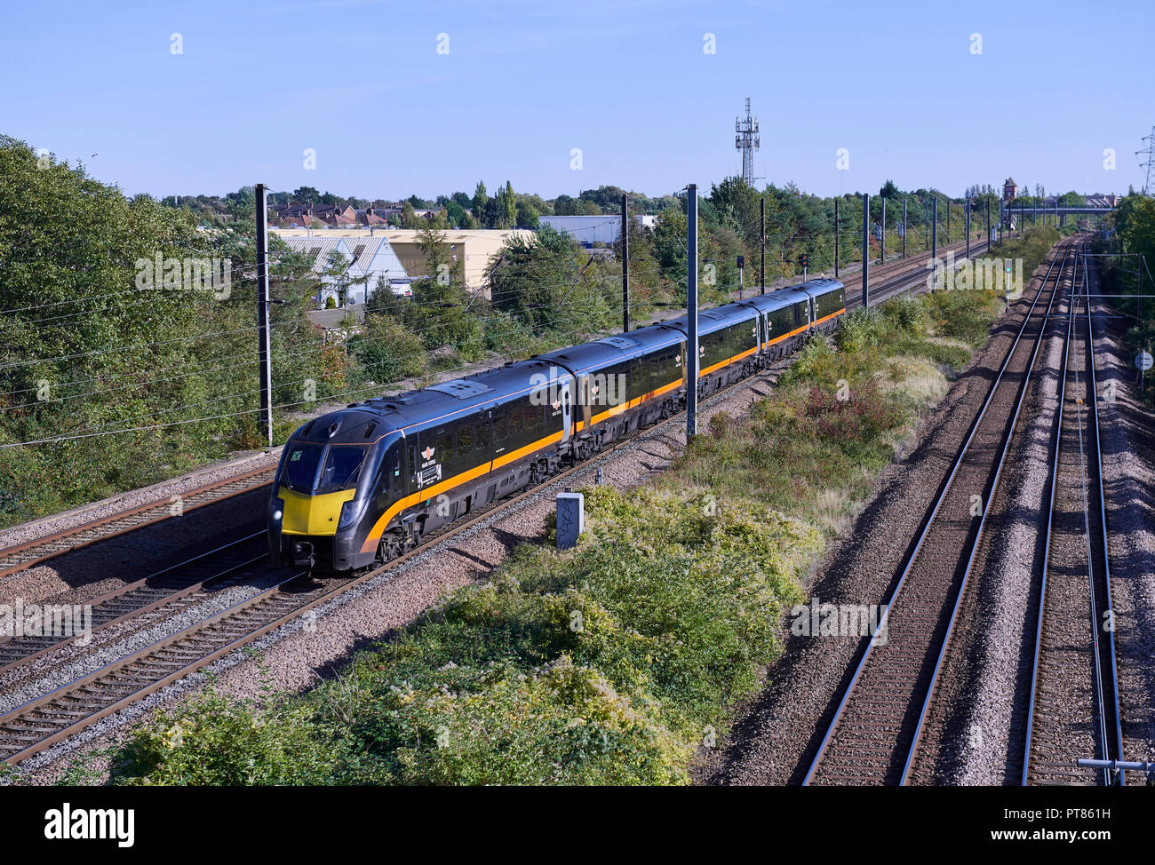 Grand Central trains 1801 112 forms 1D73 1448 London Kings Cross to Bradford Interchange service through Werrington Junction on the East Coast Mainlin - Stock Image