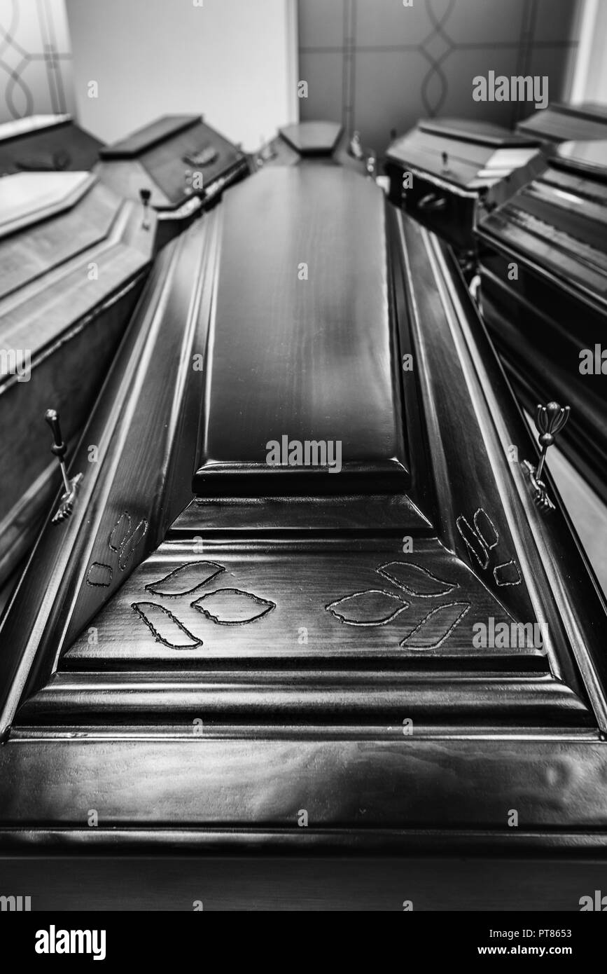 Coffins in the funeral shop - Stock Image