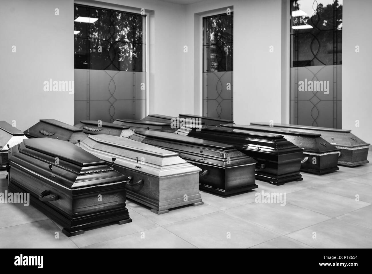 Coffins in the funeral shop Stock Photo