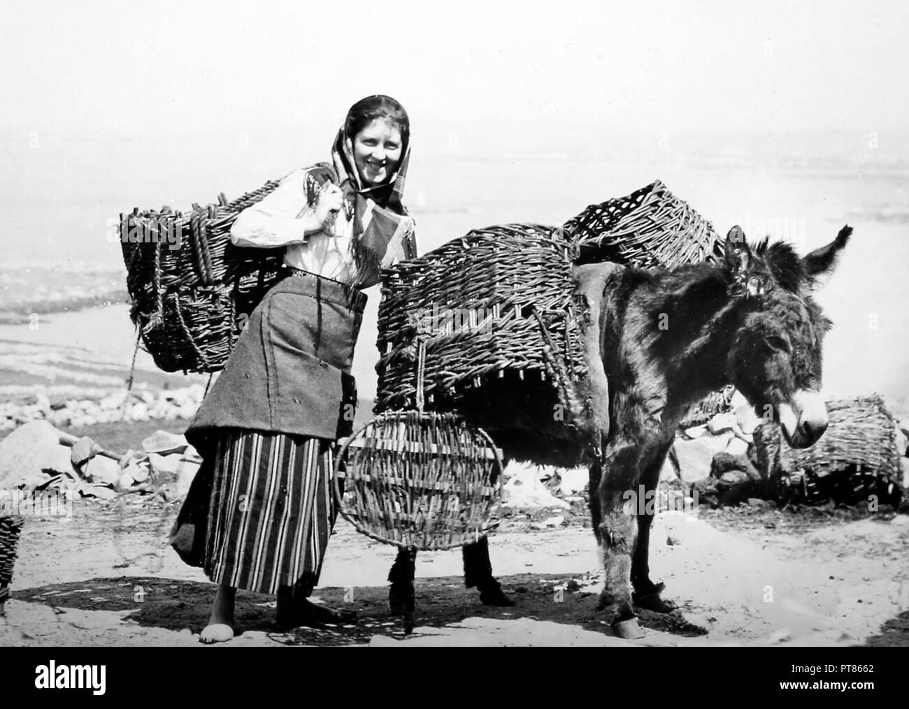 Carrying turf, Arranmore Island, West of Ireland, early 1900s - Stock Image