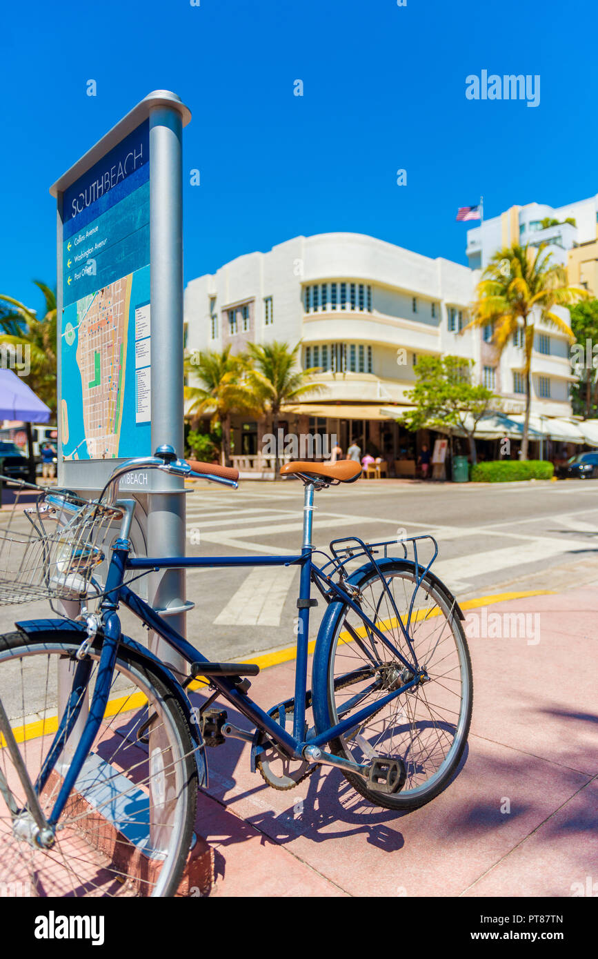 Parked Bicycle on sidewalk on Ocean Drive in Miami South Beach USA Stock Photo