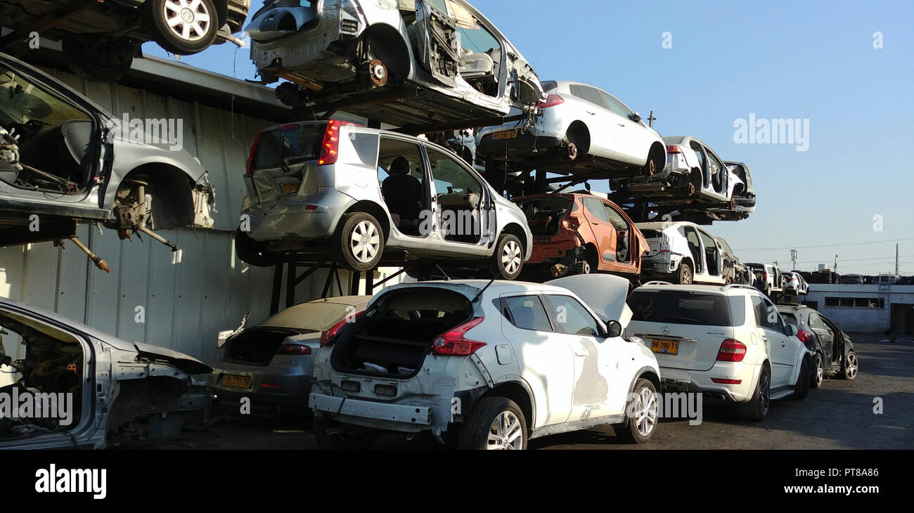 Old Cars in a scrap yard - Stock Image