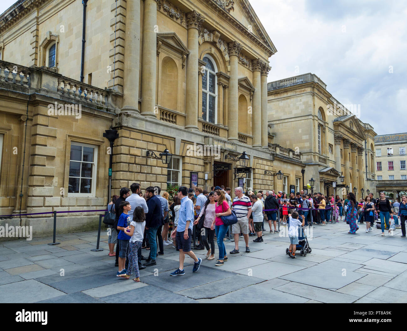 People queueing to visit the Roman Baths, Bath, Somerset, England, UK. Stock Photo