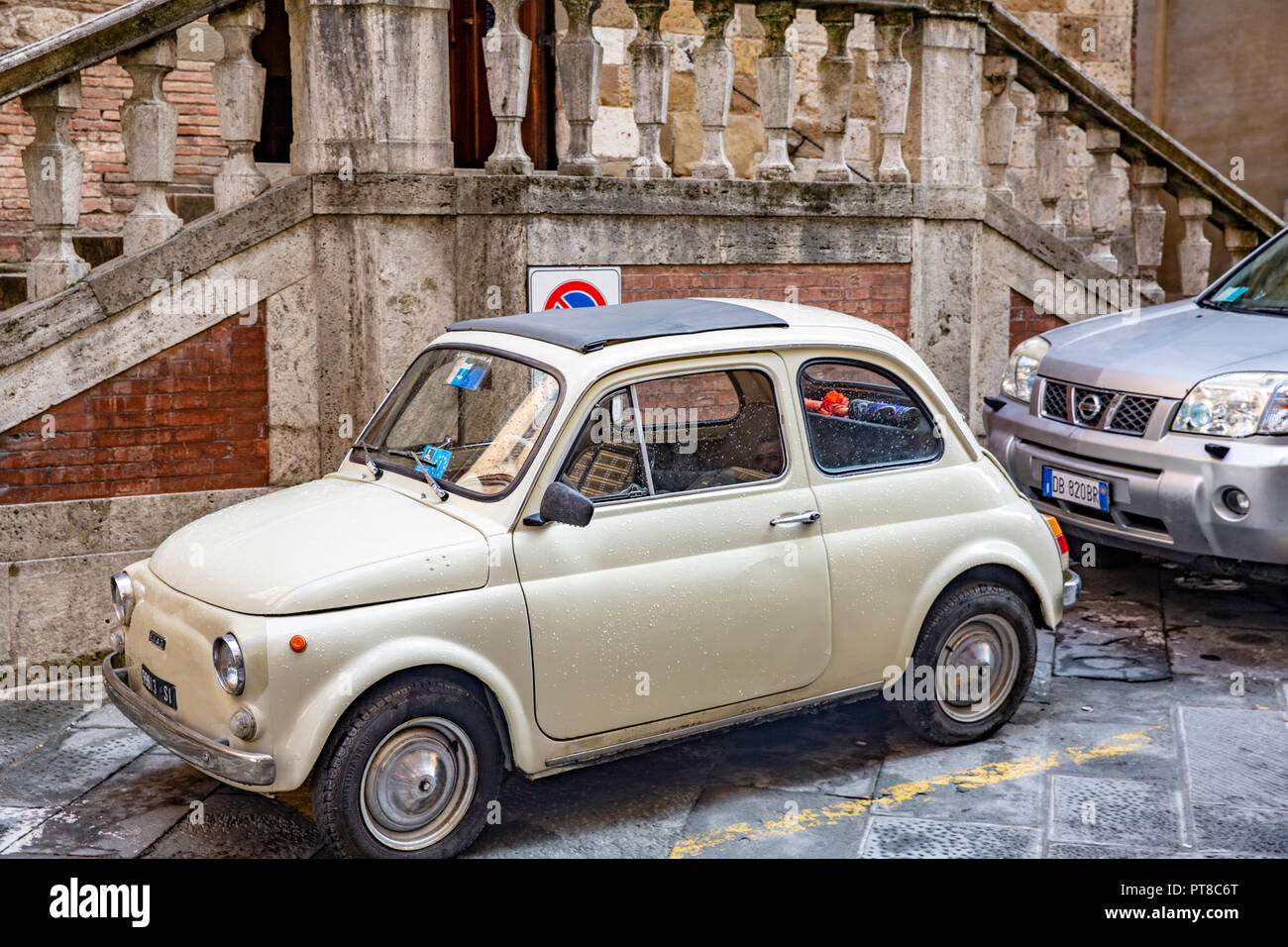 Classic cream coloured Fiat 500 car parked in the streets of Siena,Tuscany,Italy - Stock Image