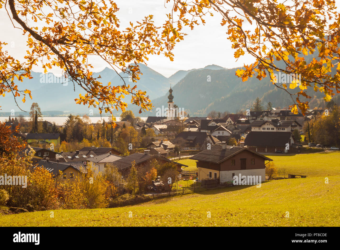 Beautiful view of alpine town St.Gilgen, Austria on Wolfgangsee lake on a sunny autumn day. - Stock Image