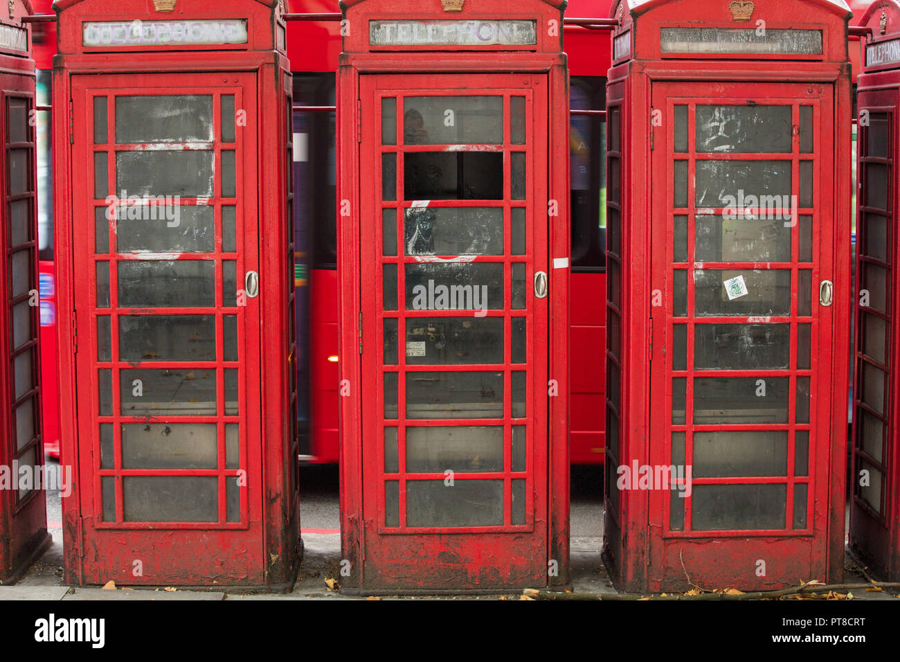 London, GB. Traditional and historical red telephone boot or boxes can still be seen in the UK. These kiosks were designed by Sir Giles Gilbert Scott. - Stock Image