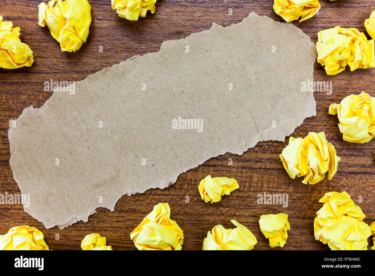 Design business concept Empty template copy space text for Ad website isolated. Blank Torn Cardboard Crumpled Sheets Color Paper Lying on Wood Surface - Stock Image
