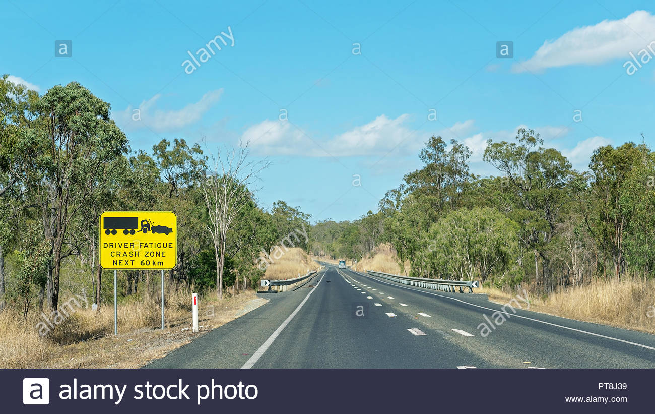 Driver fatigue crash zone sign on long highway in Queensland Australia - Stock Image