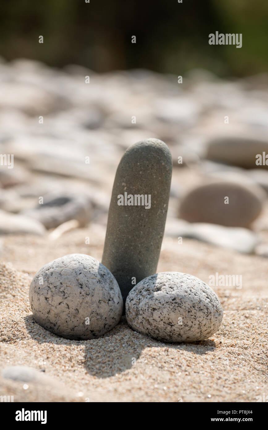 Humorous phalic-like rocks arrangement on a beach in Idaho. - Stock Image