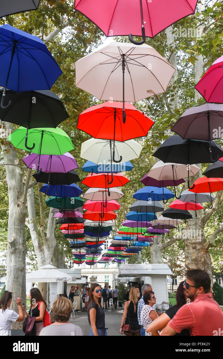 Zagreb Croatia September 14 2018 People Underneath The Street Installation Of Colorful Umbrellas Floating In The Air In Zrinjevac Park In Zagreb Stock Photo Alamy
