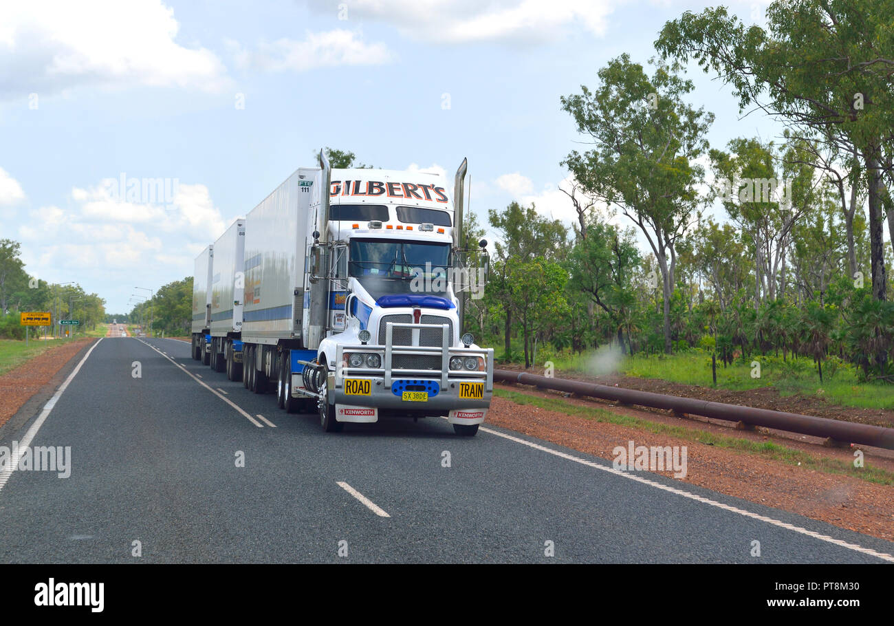 Road Train  travelling at speed through Litchfield Park region in the Northern Territory of Australia Stock Photo