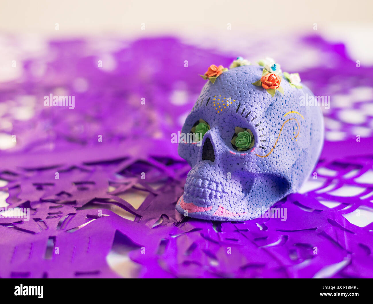 Purple Day Of The Dead Sugar Skull With Flowers On Top And Purple