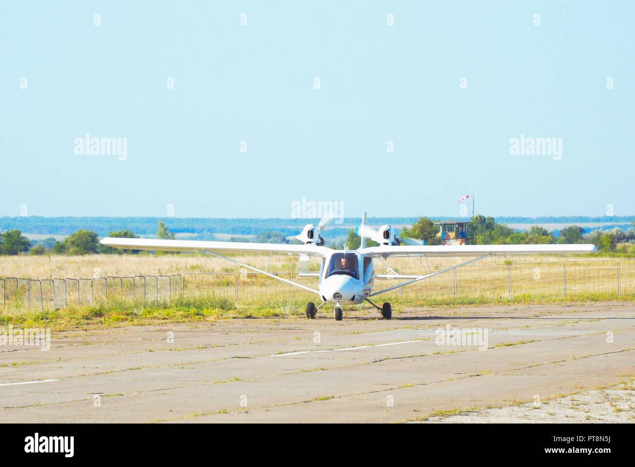 Light plane on the runway - Stock Image