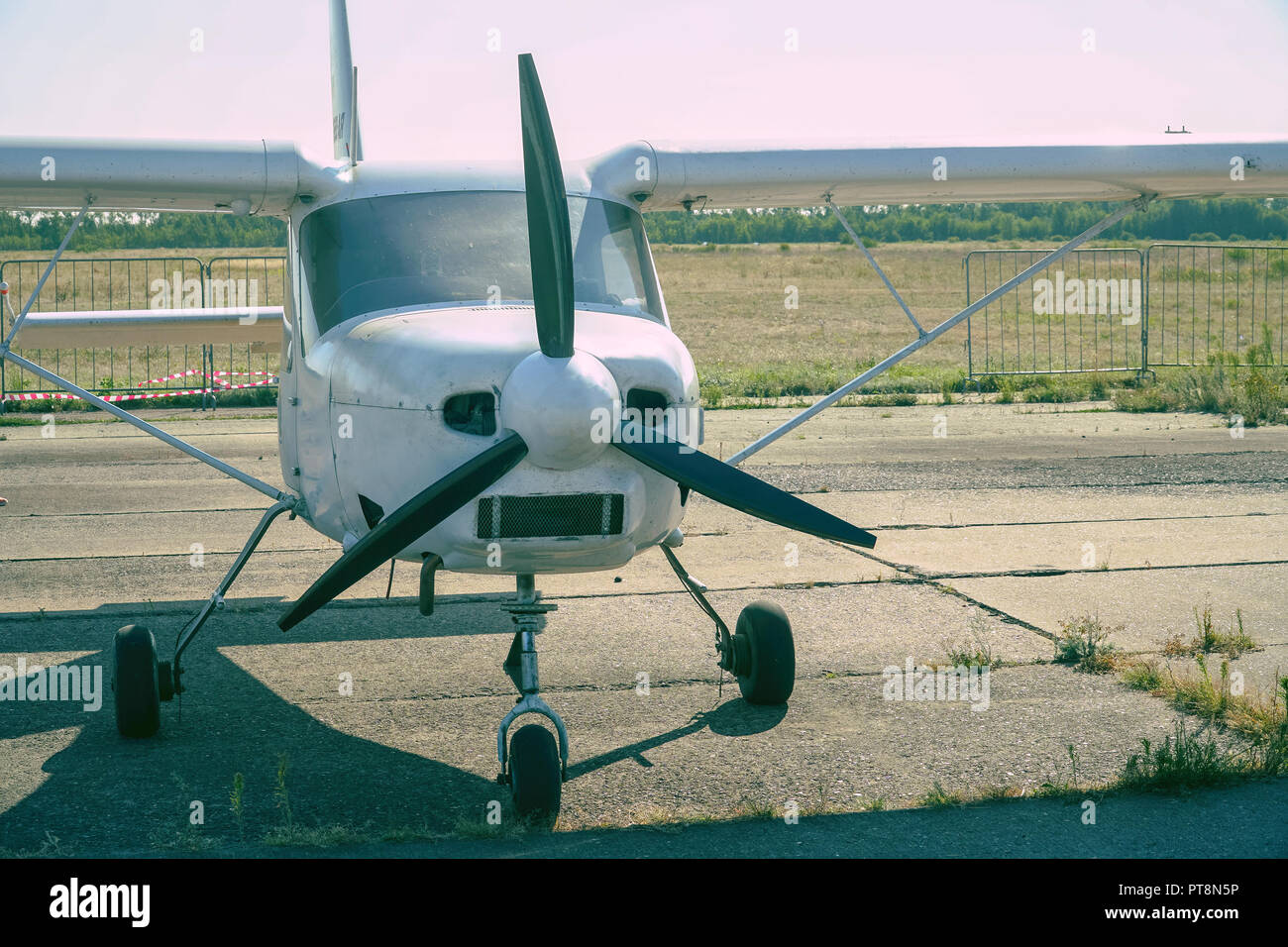 Light single-engine aircraft at the airport - Stock Image