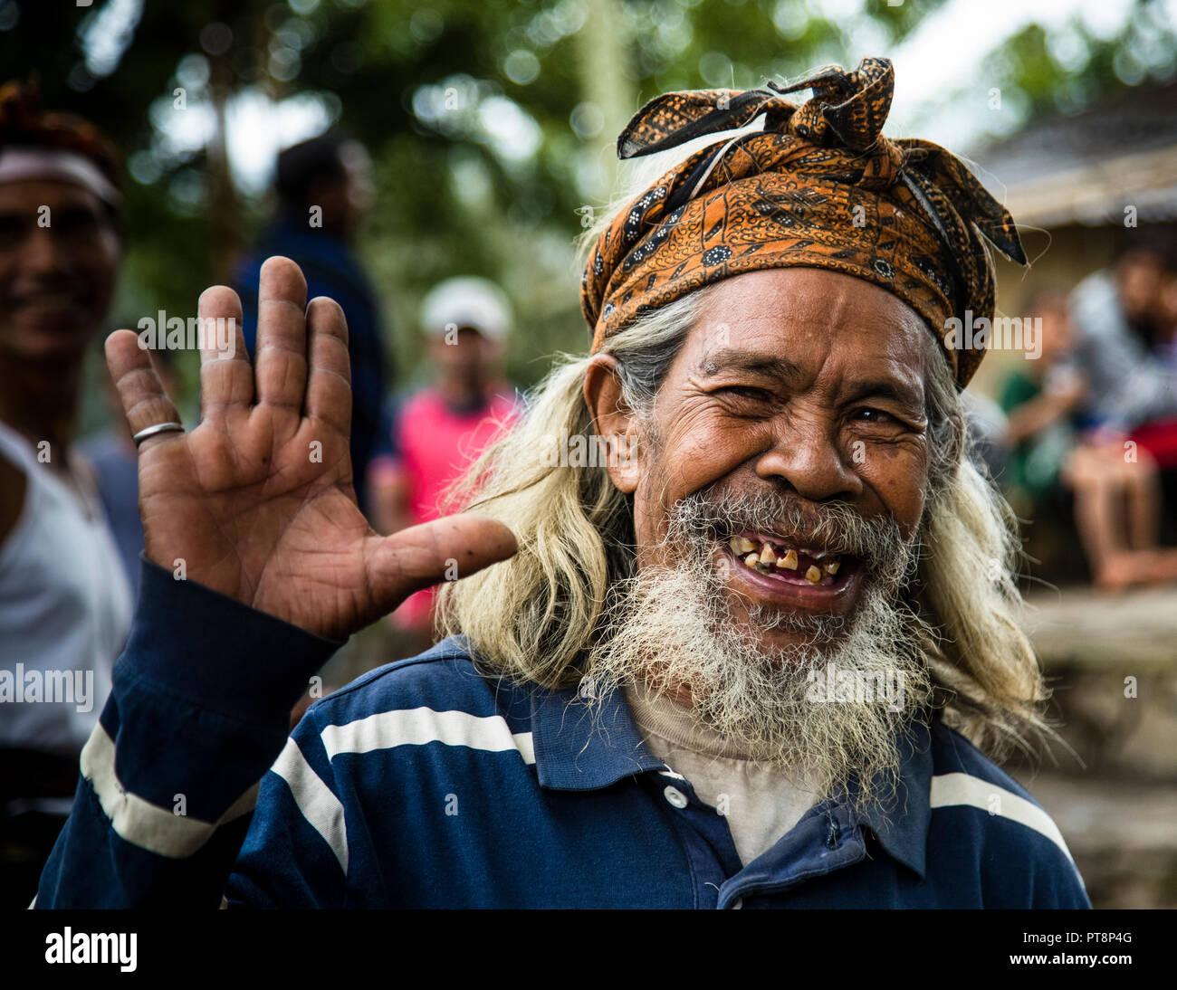 Humorous exchange between cultures, Sunda Islands, Indonesia Stock Photo
