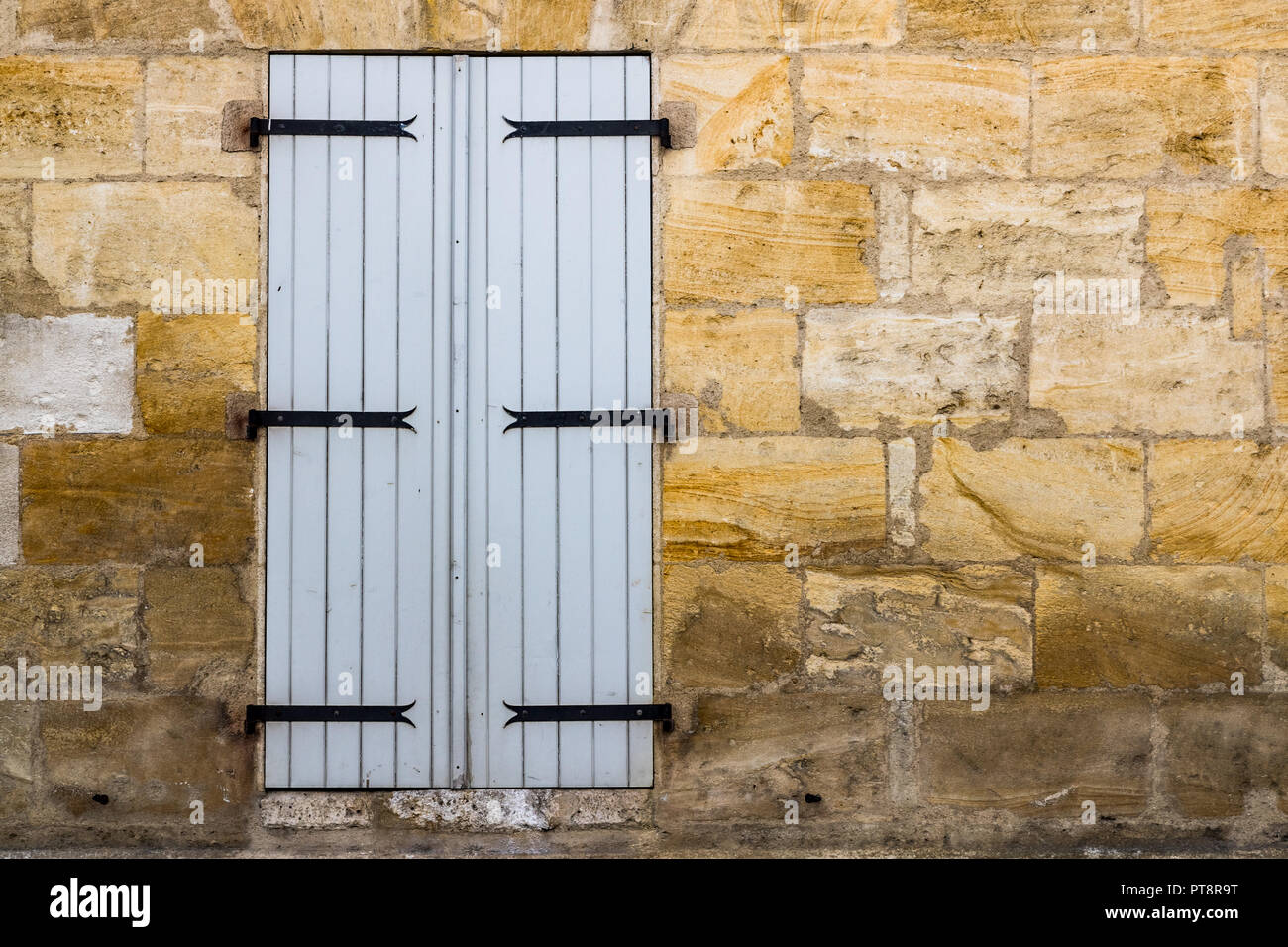 French Style White Wooden Window Shutters Closed On A Stone