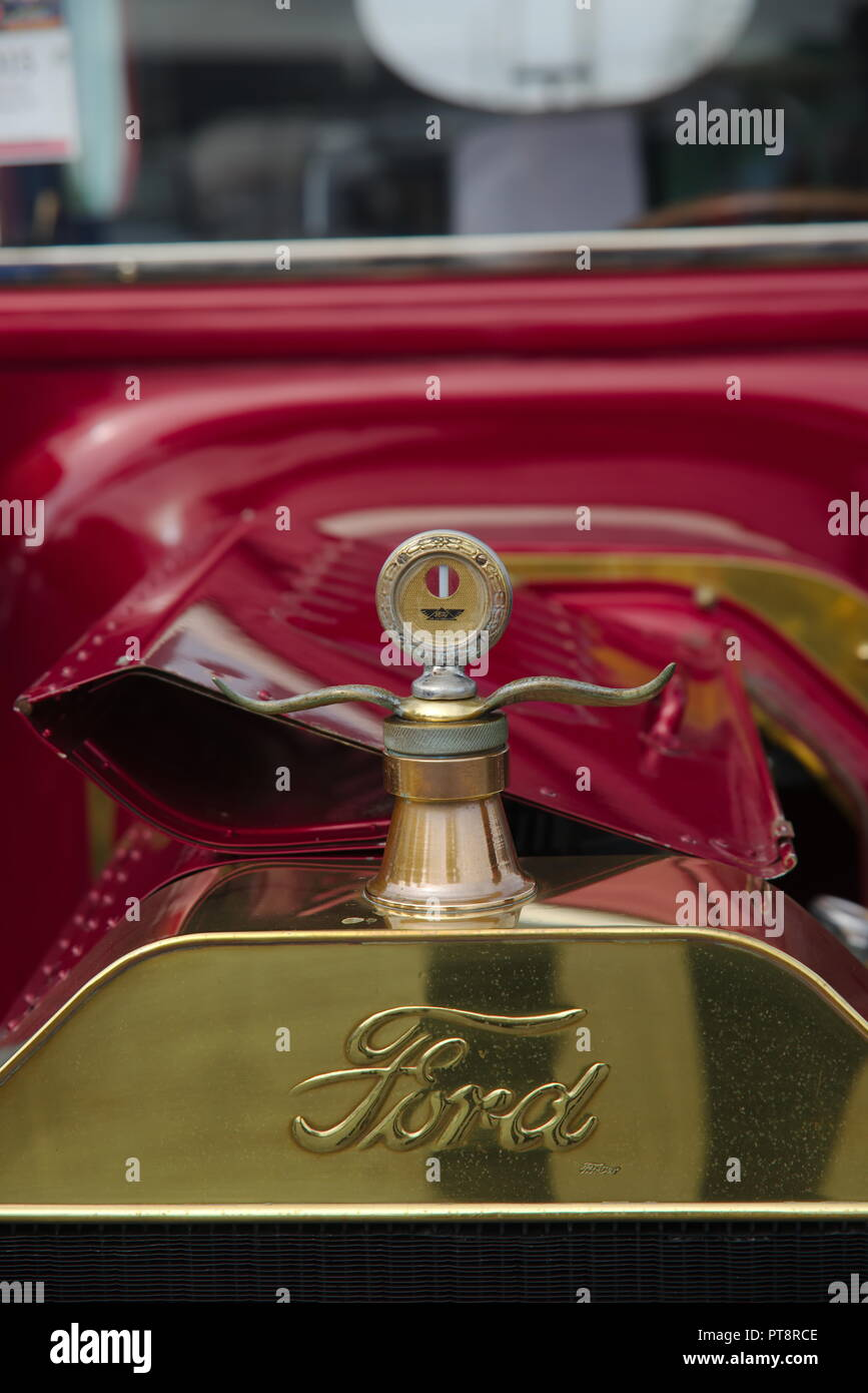 Red, 1915 Ford automobile with brass radiator and temperature guage. - Stock Image