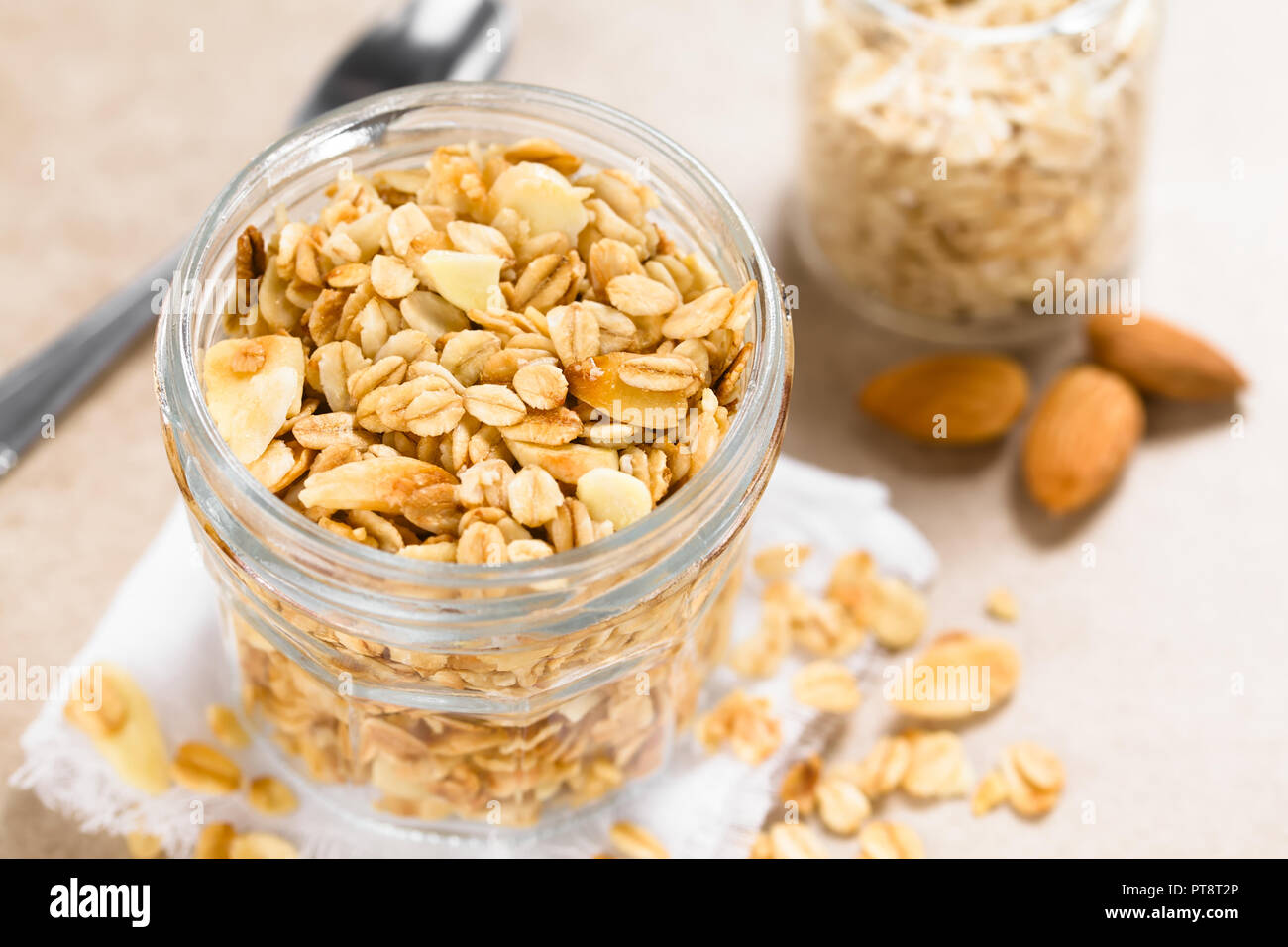 Homemade baked crunchy oatmeal, sliced almond, honey and coconut oil