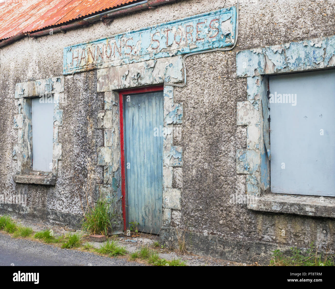 HEADFORD, IRELAND - AUGUST 8, 2018: The abandoned Hannon's Stores building next to a country road near Headford, in County Galway, Ireland. Stock Photo