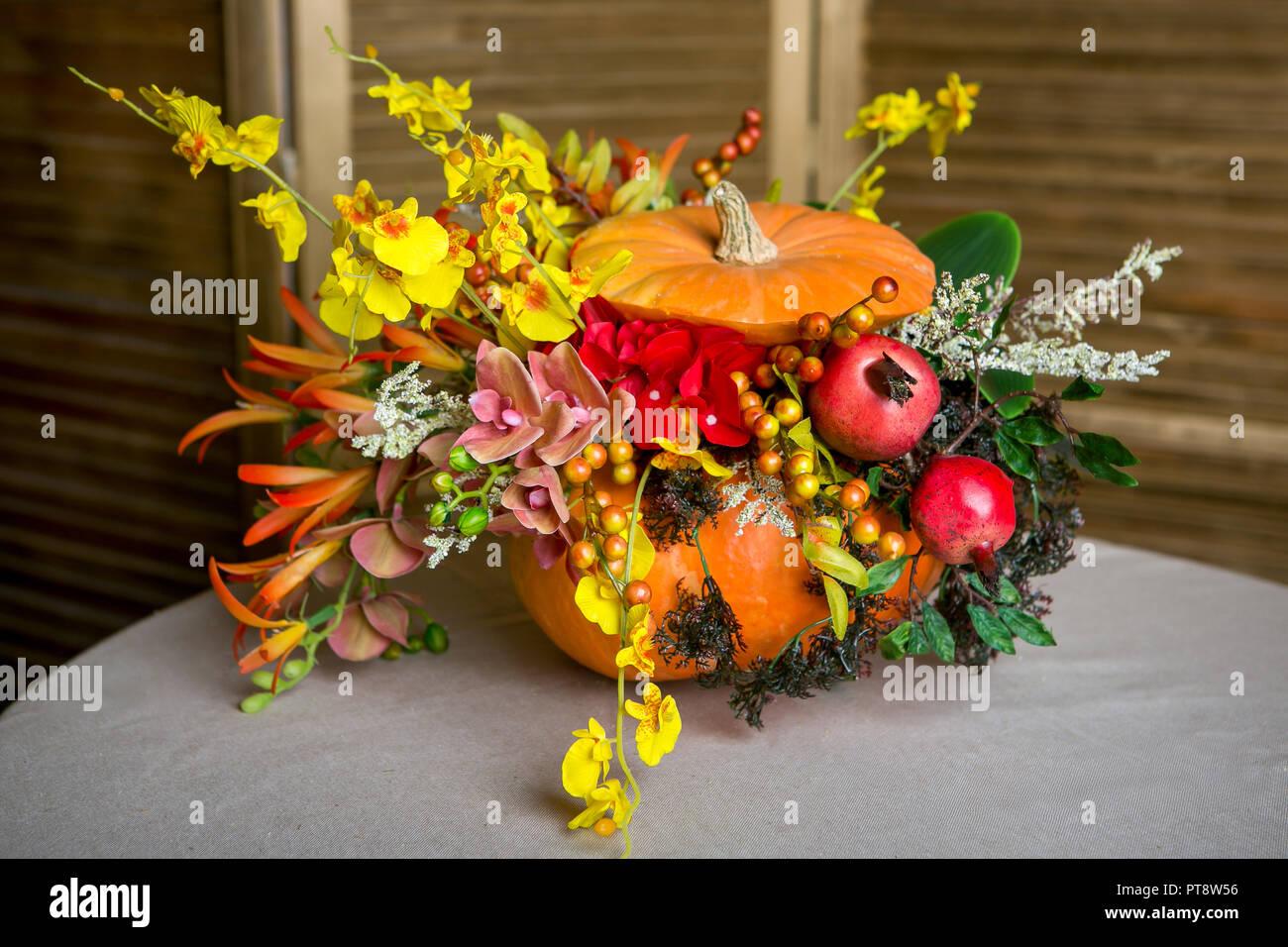 Bright Autumn Bouquet In A Pumpkin On Dark Background Stock Photo Alamy