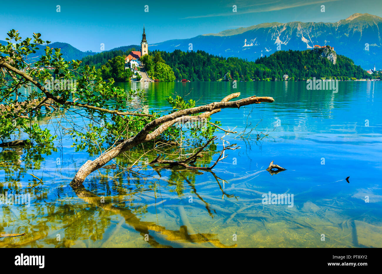 Castle and church in a lake landscape. - Stock Image