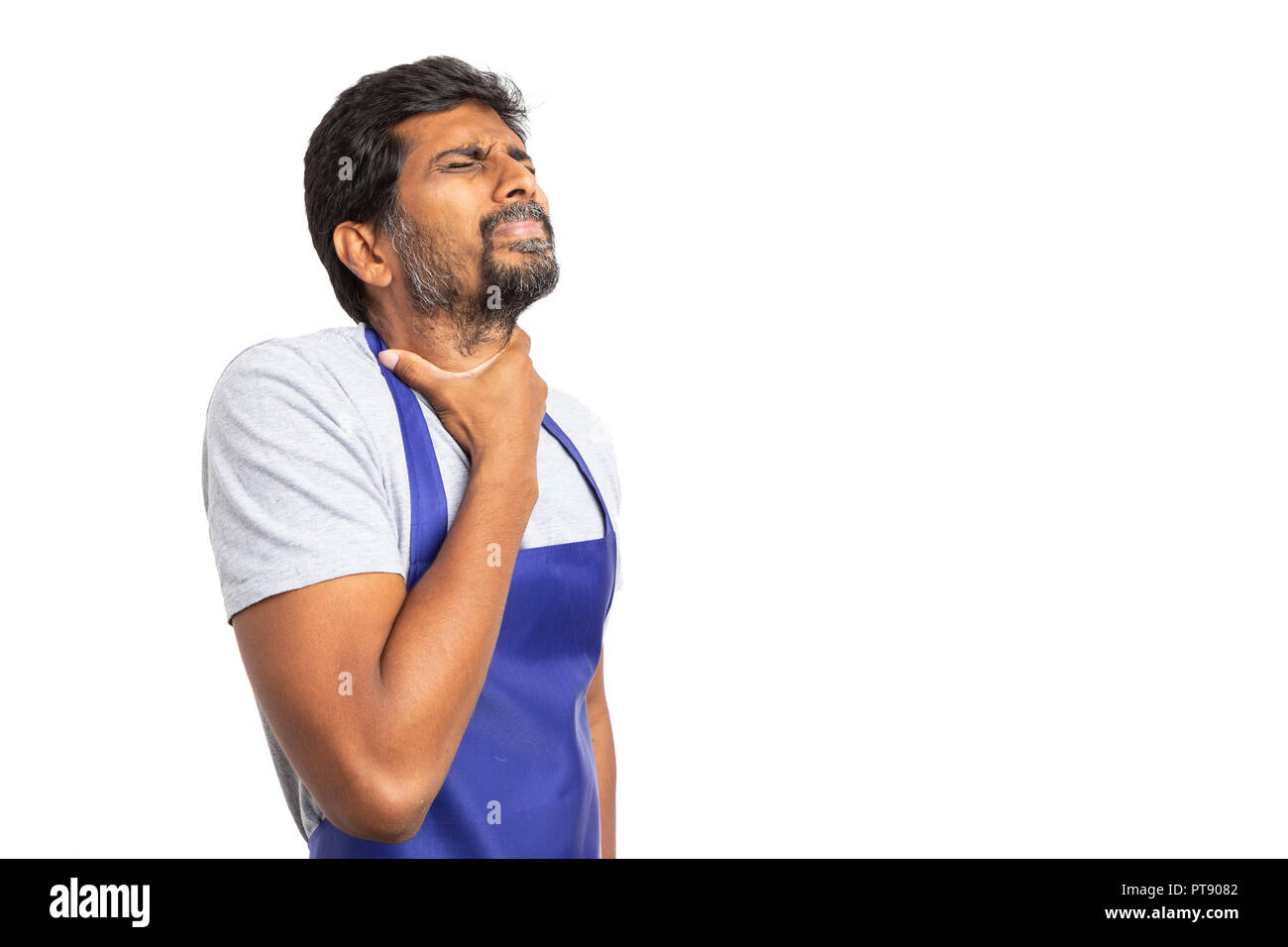 Indian supermarket or hypermarket employee having a sore throat touching neck with one hand isolated on white - Stock Image
