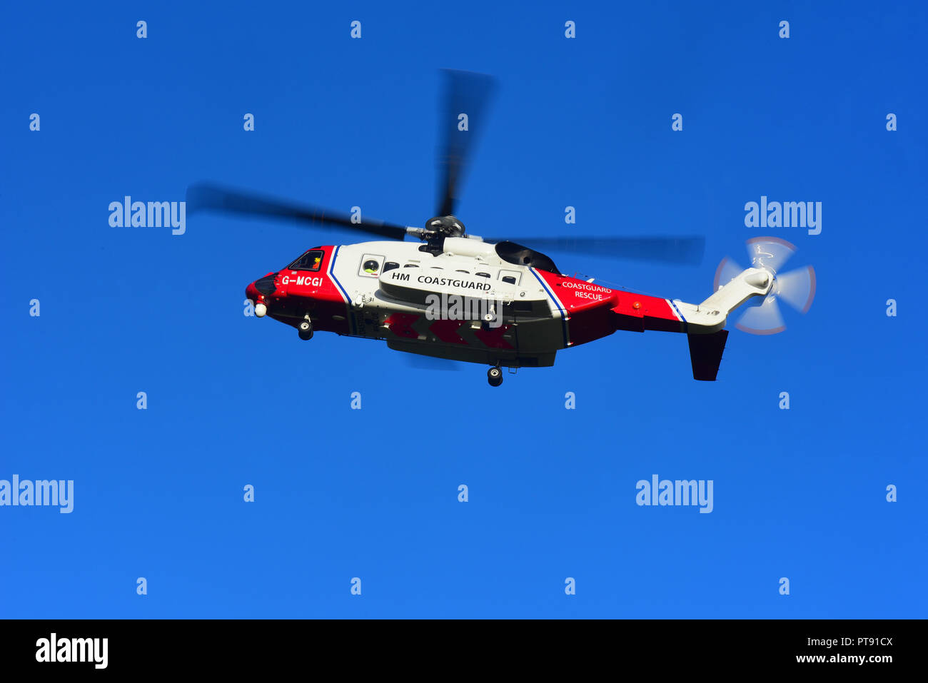 The Inverness based HM Coastguard SAR helicopter leaving its base as it heads West on a mission down to Fort William in Lochaber district. Stock Photo