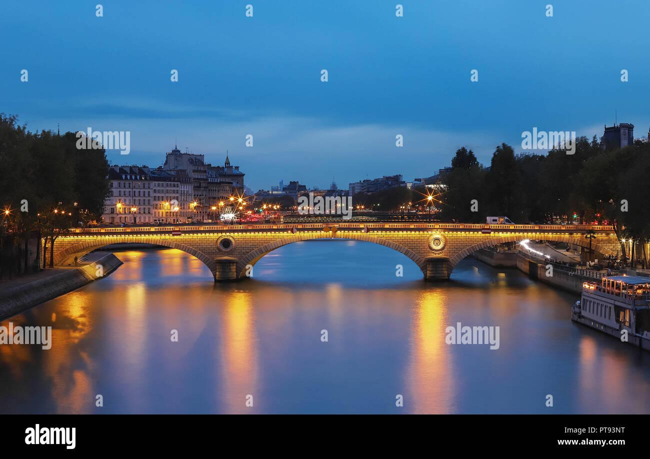 The pont Louis-Philippe is a bridge across the river Seine in Paris. It links the Quai de Bourbon on the Ile Saint Louis with the Saint Gervais neighb - Stock Image
