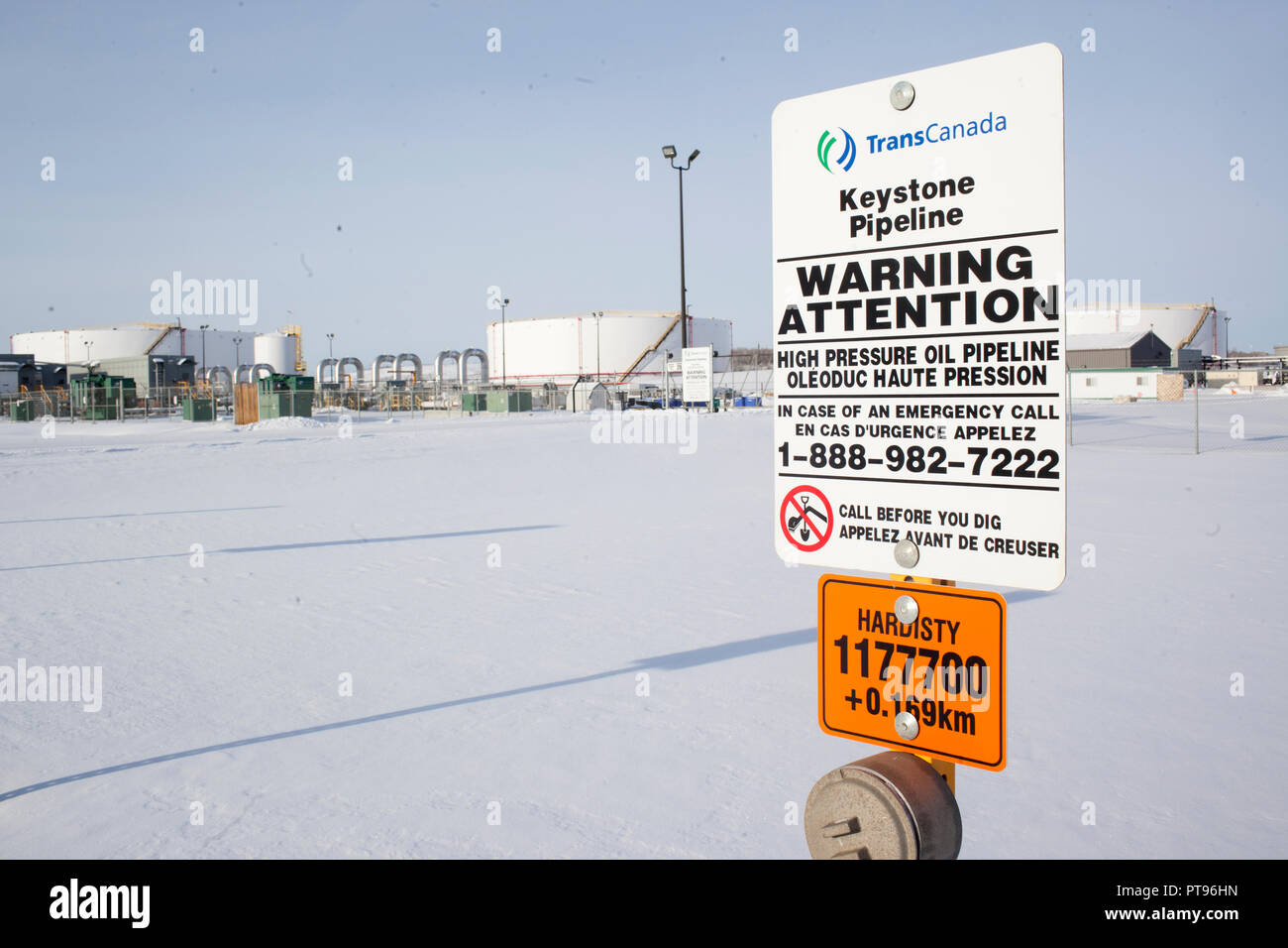 A warning sign for the Keystone Pipeline outside of TransCanada Hardisty Terminal 1, in Hardisty, Alberta, Canada, on December 7, 2013. Hardisty Terminal 1 is the starting point of the Keystone Pipeline. Construction is currently underway on TransCanada's Hardisty Terminal 2, which will be the starting point of the Keystone XL pipeline, which will transport oil from Alberta oilsands to markets in the United States. Stock Photo
