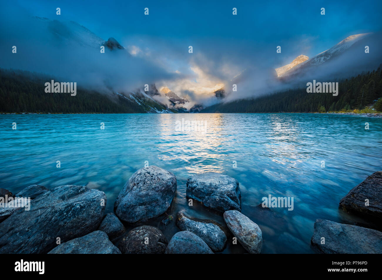Lake Louise, named Lake of the Little Fishes by the Stoney Nakota First Nations people, is a glacial lake within Banff National Park in Alberta, Canad - Stock Image