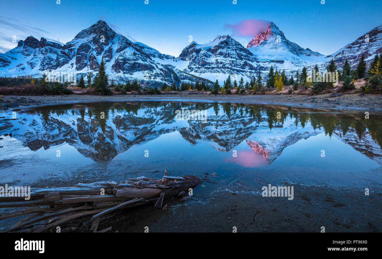 Mount Assiniboine, also known as Assiniboine Mountain, is a pyramidal peak mountain located on the Great Divide, in British Columbia/Alberta. - Stock Image