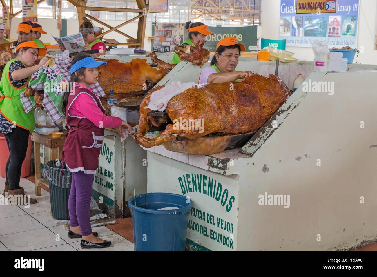 Hornados or pig roast Gualaceo indoor market nr Cuenca Ecuador Stock Photo