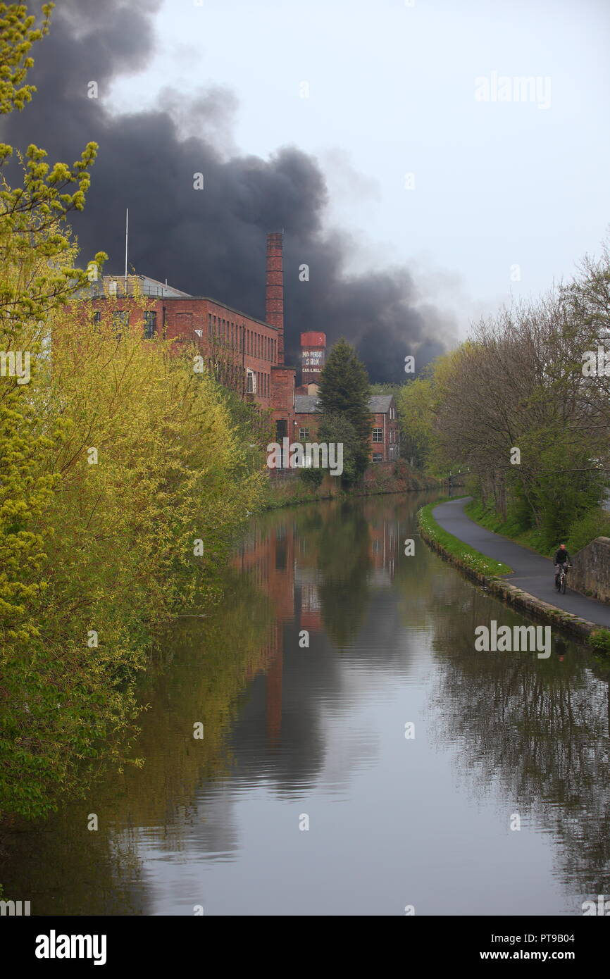 A fire on an industrial unit in Armley,Leeds which caused pollution to the local Canal. - Stock Image