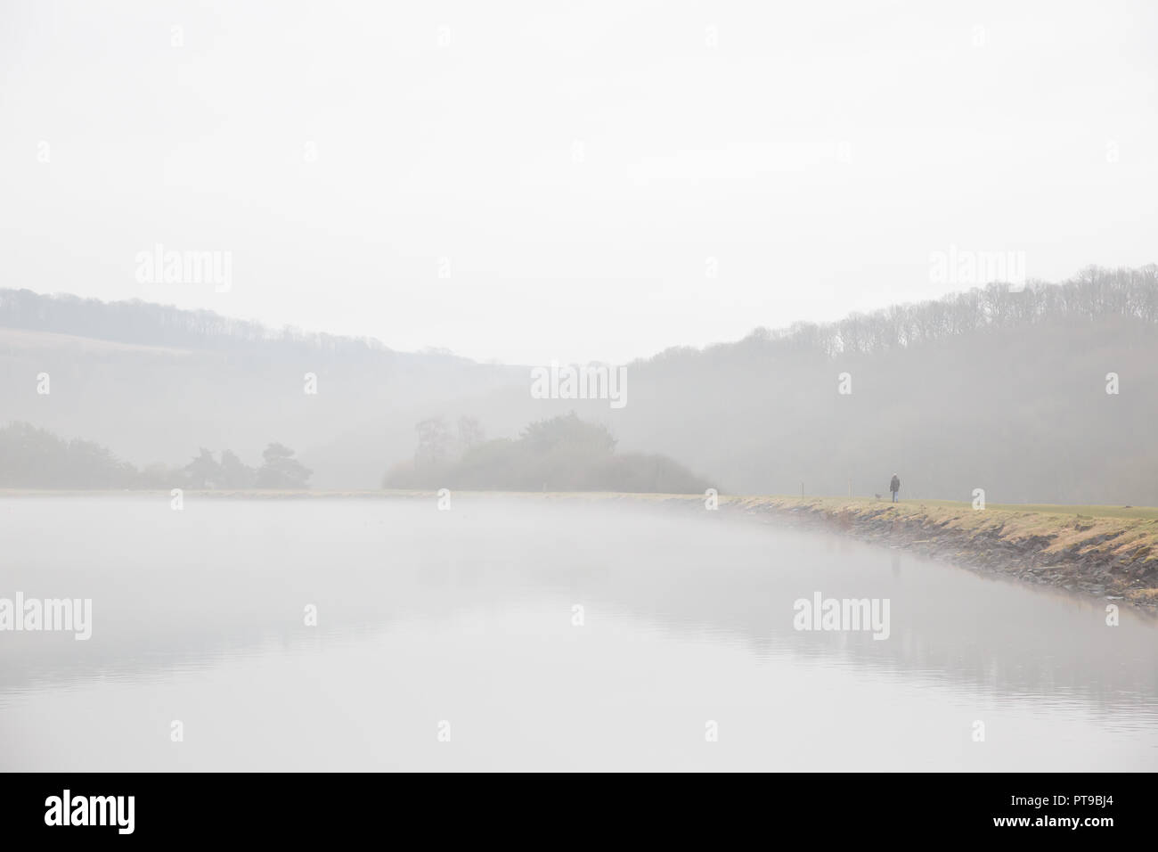 Landscape capture of foggy morning by UK reservoir. - Stock Image