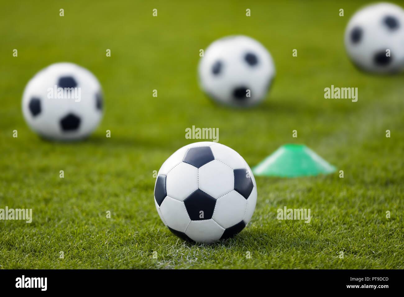 Sport Football Background. Soccer Balla on Grass Field at Stadium. Football poster. - Stock Image