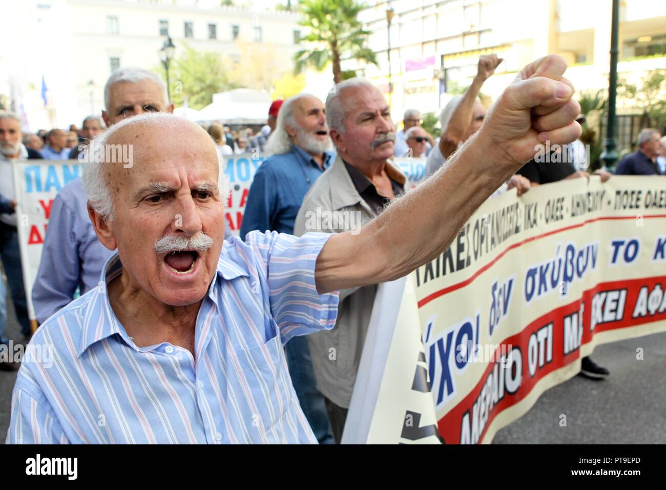 Pensioners take part in a rally outside the Labor ministry in Athens. Hundreds of pensioners demonstrated Thursday against more austerity measures pla - Stock Image
