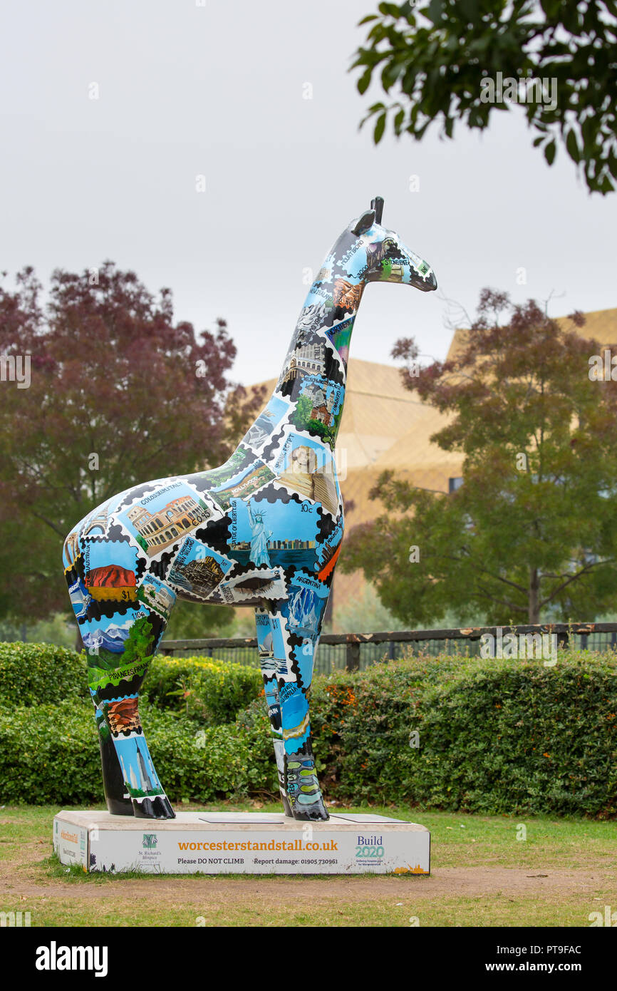 Portrait shot, decorated giraffe on display, near The Hive, city centre:  Worcester Stands Tall campaign raising funds for St Richard's Hospice appeal. Stock Photo
