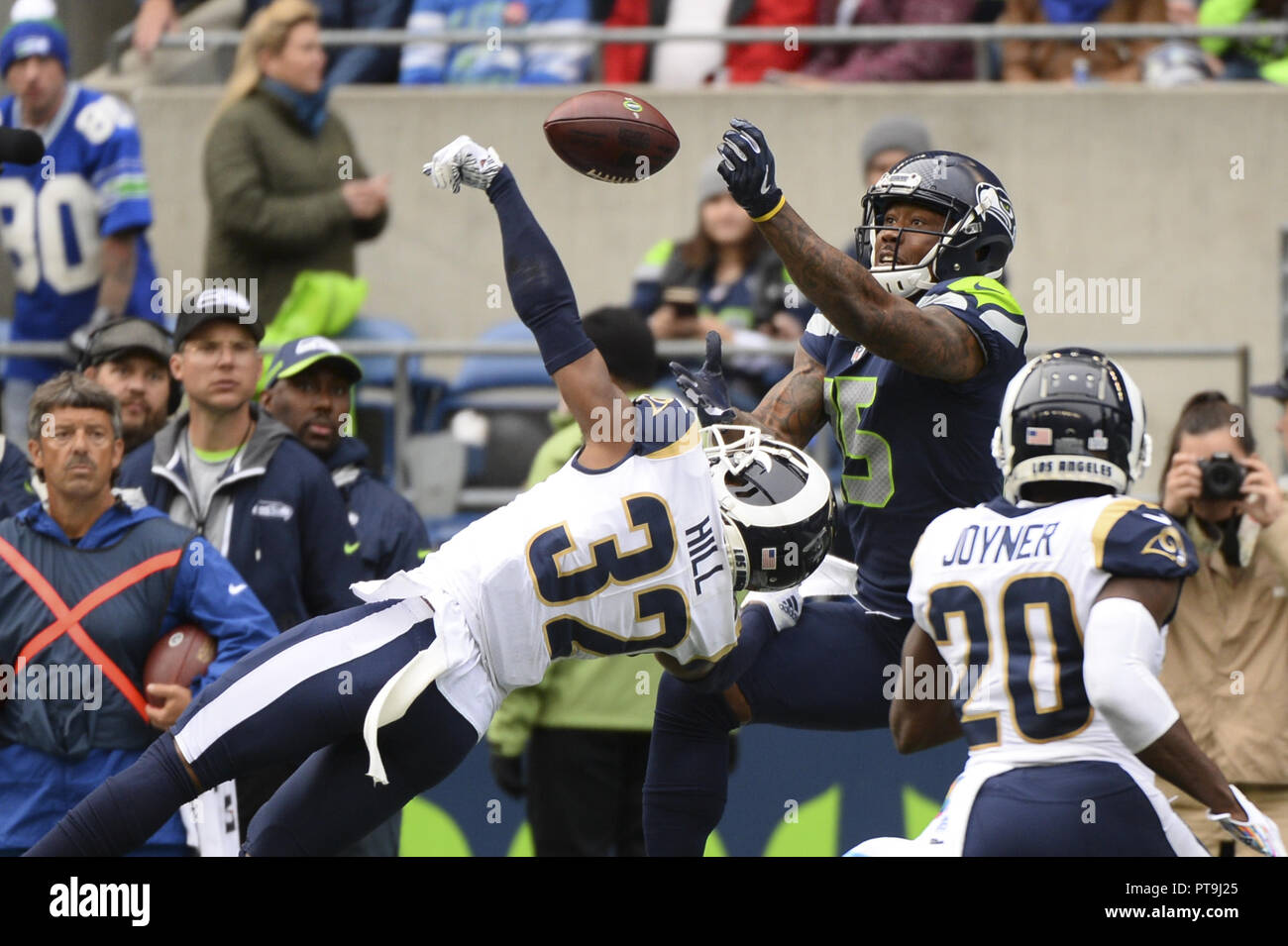 a6b055f8 Seattle, Washington, USA. 7th Oct, 2018. Seahawk receiver BRANDON MARSHALL  (15) and defender TROY HILL (32) go up for a RUSSELL WILSON ...