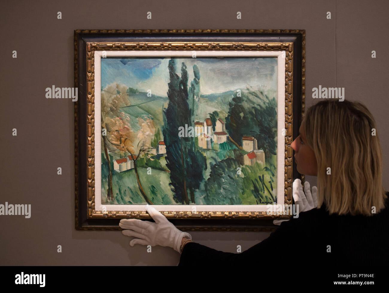 Bonhams, New Bond Street, London, UK. 8 October, 2018. Bonhams Impressionist and Modern Art Sale preview opens. Image: Maurice de Vlaminck, Paysage aux trois cyprès, estimated at £70,000-90,000. Credit: Malcolm Park/Alamy Live News. - Stock Image