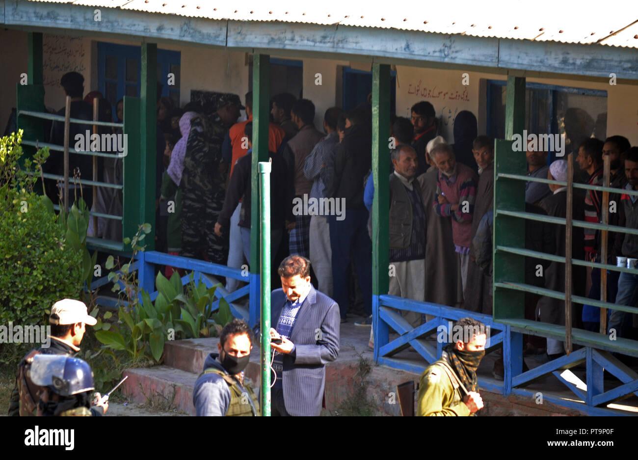 October 7, 2018 - Srinagar, Jammu and Kashmir, India - People stand