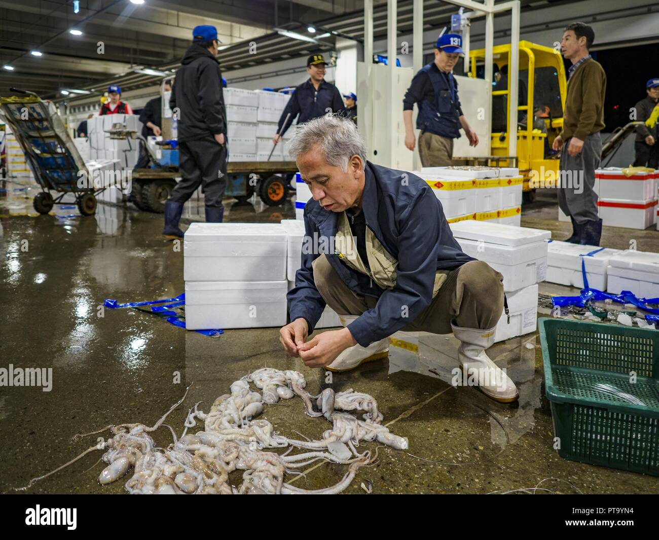 Seoul, Gyeonggi, South Korea. 9th Oct, 2018. A man cleans octopi after the octopus auction in the Noryangjin Fish Market. The auctions start about 01.00 AM and last until 05.00 AM. Noryangjin Fish Market is the largest fish market in Seoul and has been in operation since 1927. It opened in the current location in 1971 and was renovated in 2015. The market serves both retail and wholesale customers and has become a tourist attraction in recent years. Credit: Jack Kurtz/ZUMA Wire/Alamy Live News - Stock Image