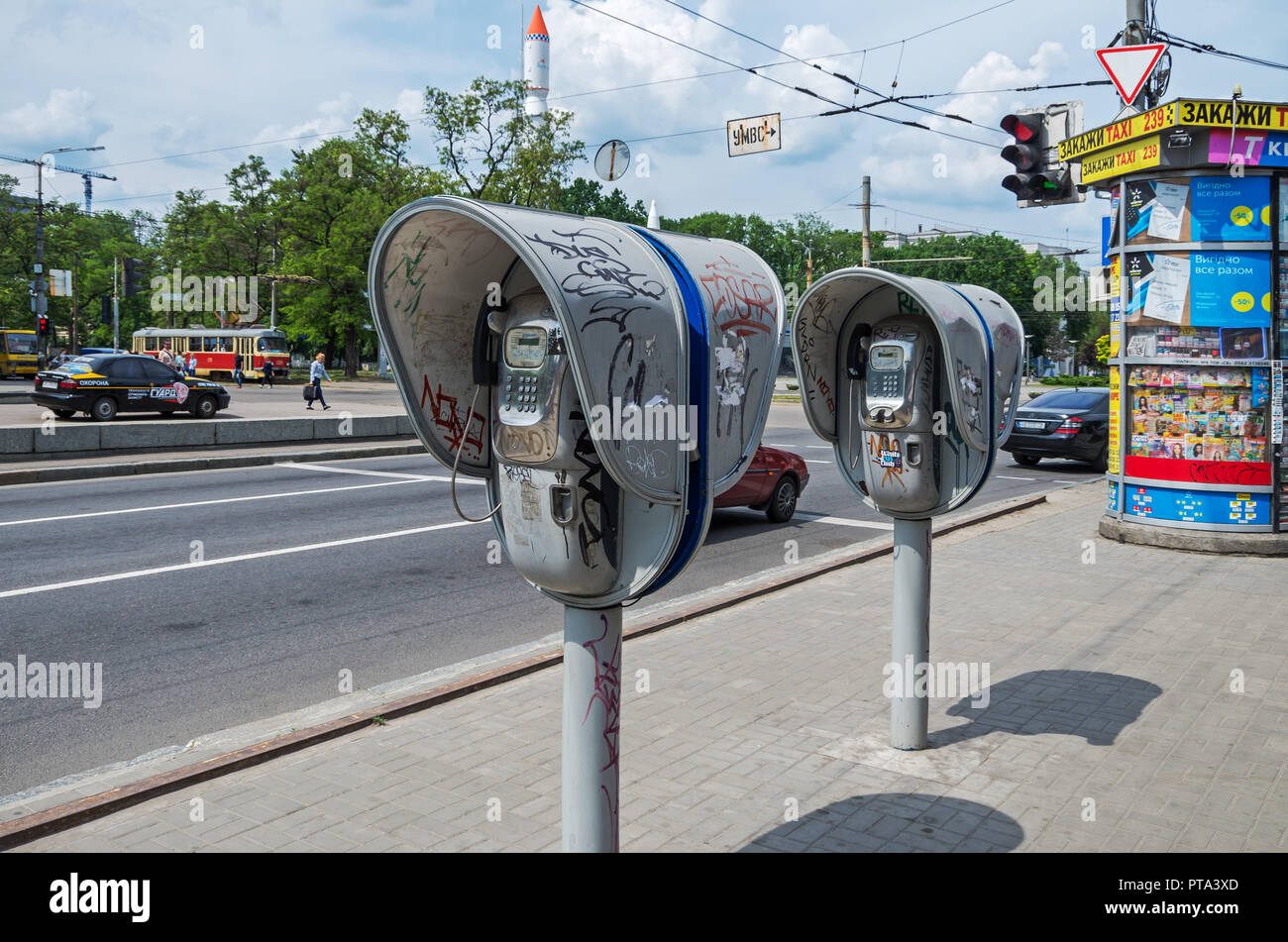 Dnipro, Ukraine - May 23, 2018: Old vandalized payphones at crossroads of the streets of Dnipro city. Obsolete means of telephone communication - Stock Image