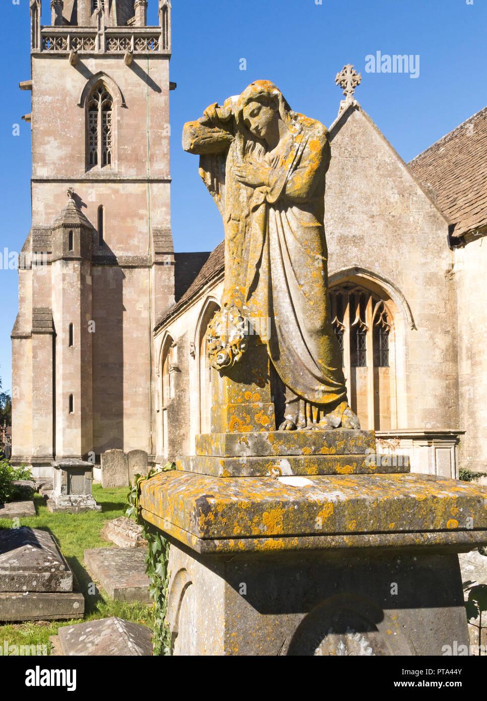 Statue on grave in graveyard of Church of Saint Bartholomew, Corsham, Wiltshire, England, UK Stock Photo