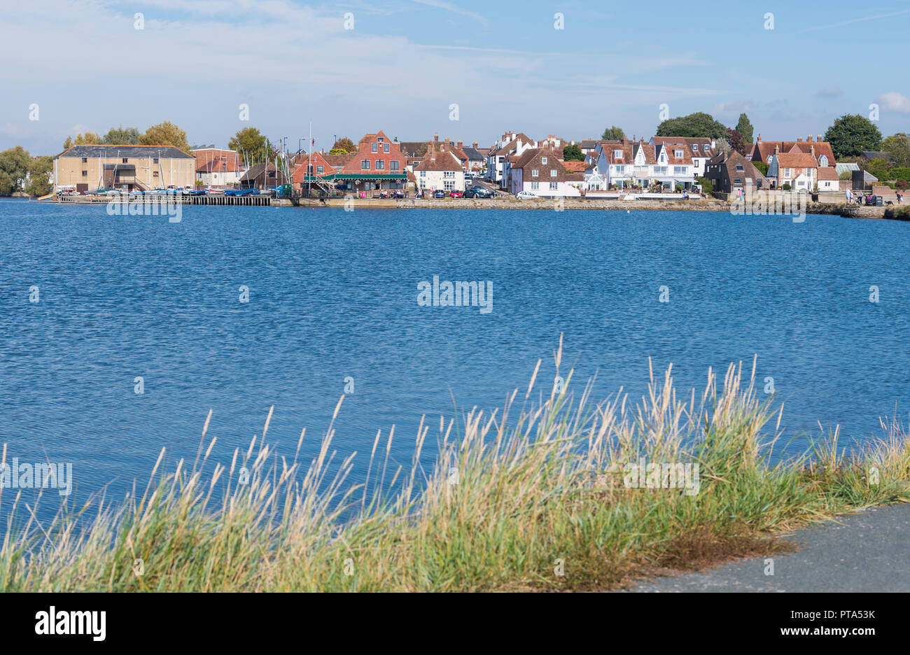 View of the British town of Emsworth across Slipper Mill Pond in Autumn in Emsworth, Hampshire, England, UK. - Stock Image