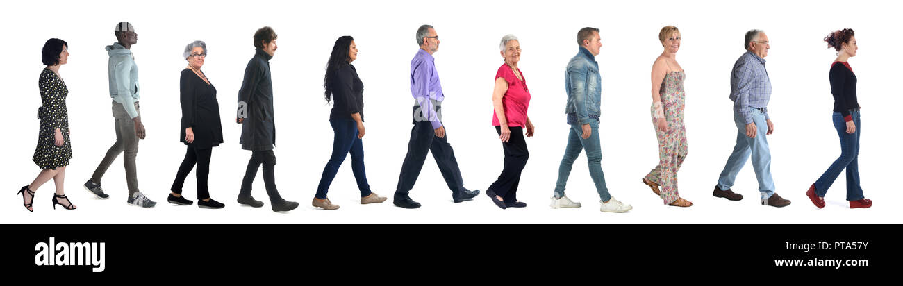 group of mixed people walking on white - Stock Image